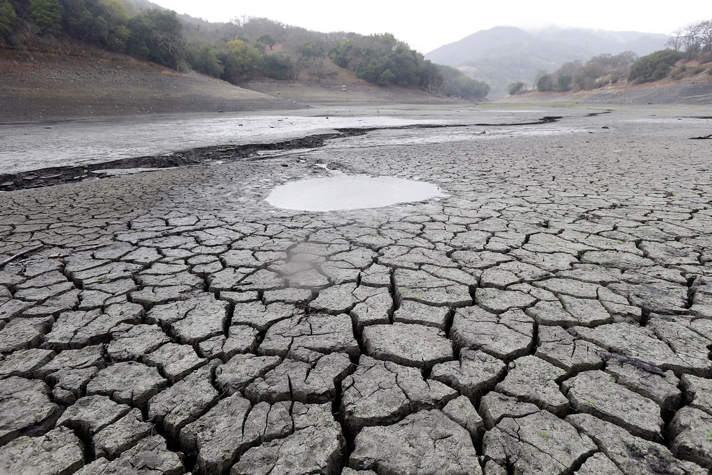 . This Feb. 7, 2014, file photo shows the cracked-dry bed of the Almaden Reservoir in San Jose, Calif.     (AP Photo/Marcio Jose Sanchez, File)