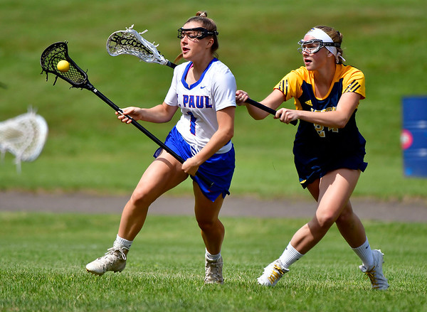5/29/2019 Mike Orazzi | Staff St. Paul's Emma Cretella (1) and Weston's Camryn Kirk (24) during Wednesday's Class S First Round lacrosse match in Bristol.