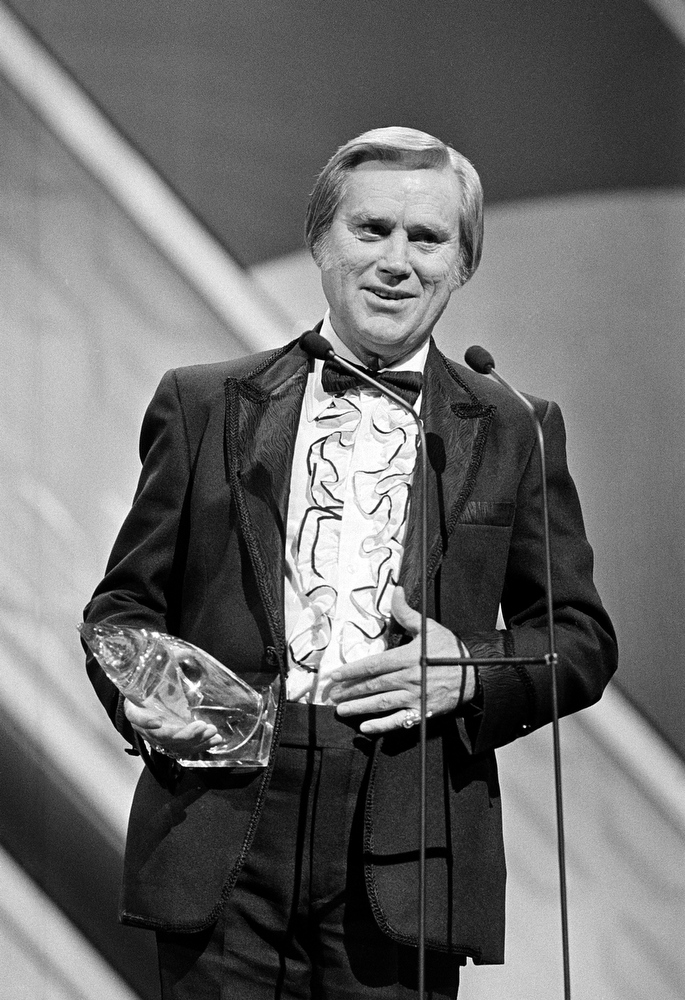 ". FILE - In this Oct. 1986 file photo,   George Jones accepts his 1985 award at the Country Music Association (CMA) awards show in Nashville, Tenn.   Jones, the peerless, hard-living country singer who recorded dozens of hits about good times and regrets and peaked with the heartbreaking classic ""He Stopped Loving Her Today,\"" has died. He was 81. Jones died Friday, April 26, 2013 at Vanderbilt University Medical Center in Nashville after being hospitalized with fever and irregular blood pressure, according to his publicist Kirt Webster.  (AP Photo, file)"