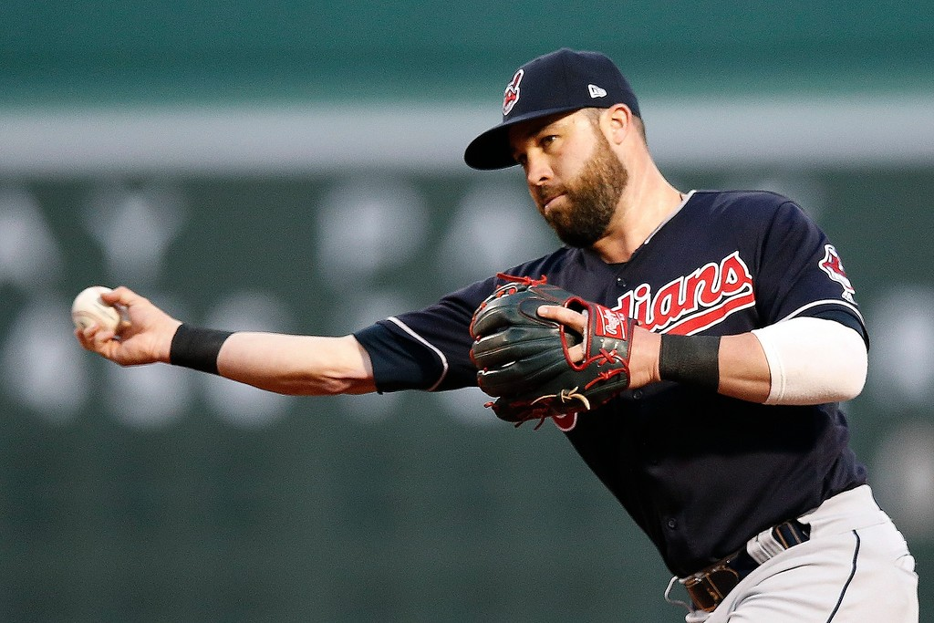. Cleveland Indians\' Jason Kipnis throws to first base on the ground out by Boston Red Sox\'s Andrew Benintendi during the first inning of a baseball game in Boston, Tuesday, Aug. 21, 2018. (AP Photo/Michael Dwyer)