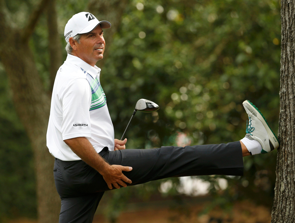 Description of . Fred Couples of the U.S. stretches before hitting his tee shot on the second hole during second round play in the 2013 Masters golf tournament at the Augusta National Golf Club in Augusta, Georgia, April 12, 2013.  REUTERS/Mark Blinch