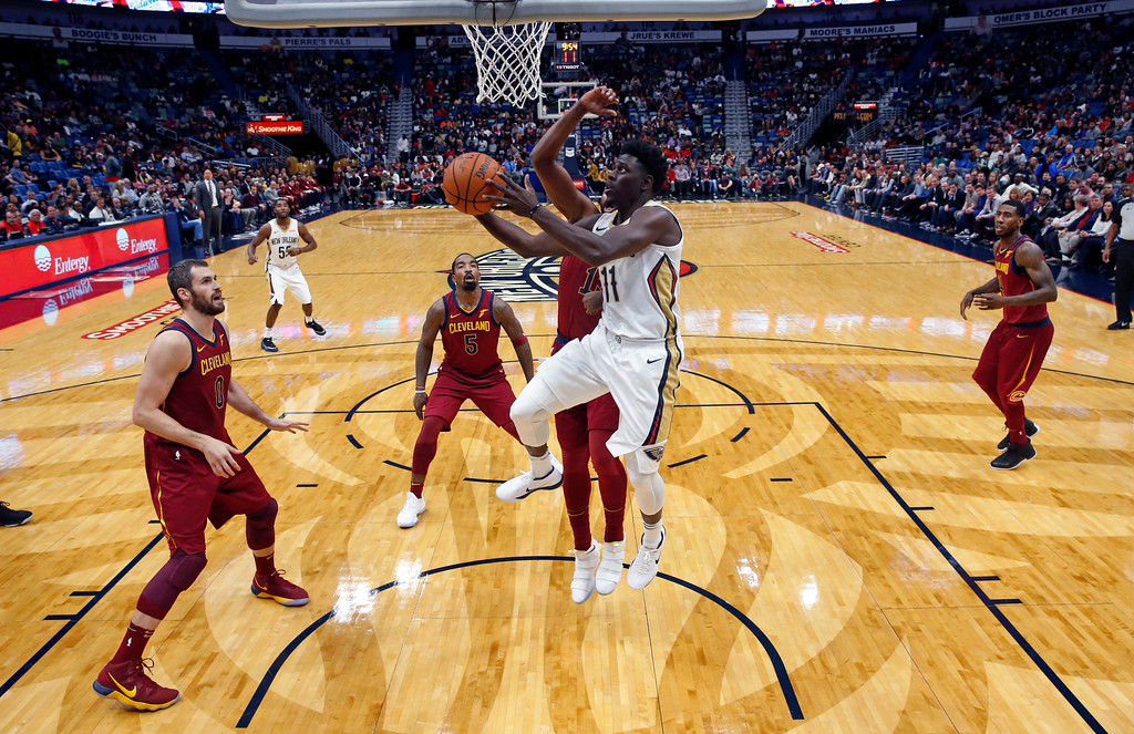 . New Orleans Pelicans guard Jrue Holiday (11) drives to the basket in the first half of an NBA basketball game against the Cleveland Cavaliers in New Orleans, Saturday, Oct. 28, 2017. (AP Photo/Gerald Herbert)