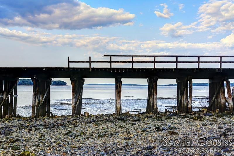 Low tide under the railroad bridge.