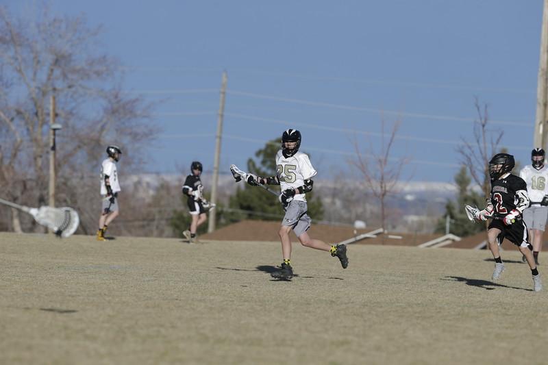 JPM0268-JPM0268-Jonathan first HS lacrosse game March 9th.jpg