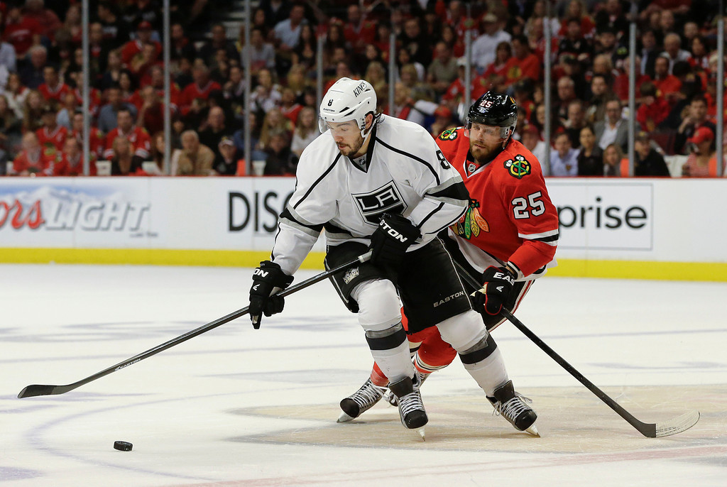 . Los Angeles Kings defenseman Drew Doughty (8) moves the puck up the ice against Chicago Blackhawks left wing Viktor Stalberg (25) during the first period of Game 1 of an NHL hockey Stanley Cup Western Conference finals, Saturday, June 1, in Chicago. (AP Photo/Nam Y. Huh)