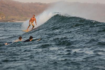 Couples enjoy a Panga trip to a secret surf break, Emerald Coast  Nicaragua.