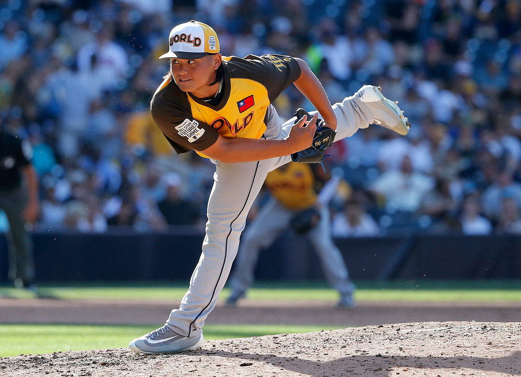 . World Team pitcher Chih-Wei Hu, of the Tampa Bay Rays, throws against the U.S. Team during the fifth inning of the All-Star Futures baseball game, Sunday, July 10, 2016, in San Diego. (AP Photo/Lenny Ignelzi)