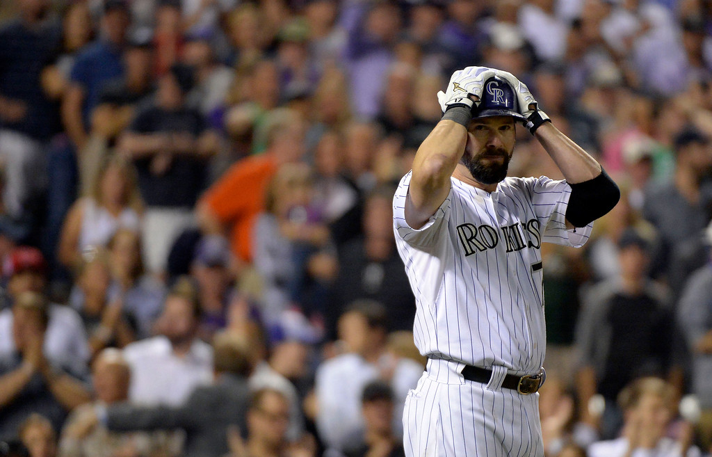 . Todd Helton (17) of the Colorado Rockies stands in the on deck circle as he waits for his at bat agains the Boston Red Sox September 25, 2013 at Coors Field. (Photo By John Leyba/The Denver Post)