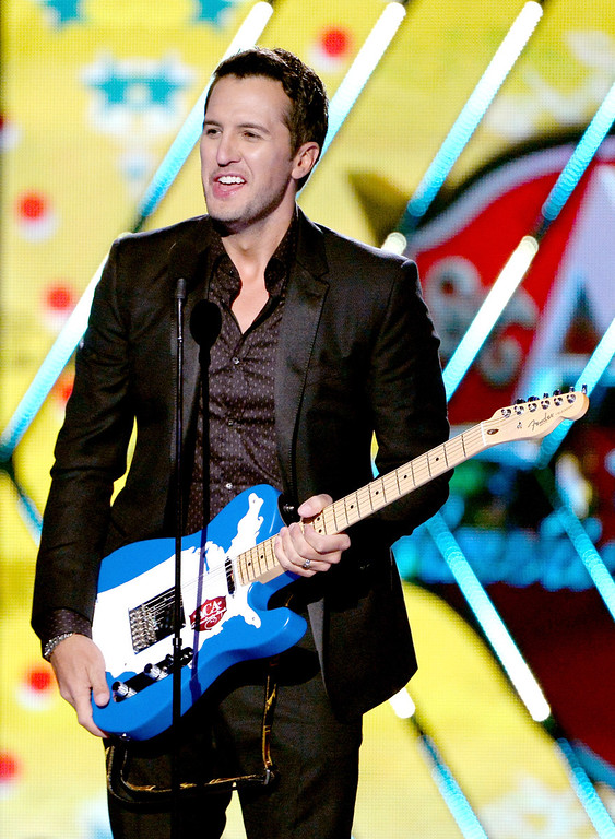 . Recording artist Luke Bryan accepts the Male Artist of the Year award onstage during the 2013 American Country Awards at the Mandalay Bay Events Center on December 10, 2013 in Las Vegas, Nevada.  (Photo by Ethan Miller/Getty Images)