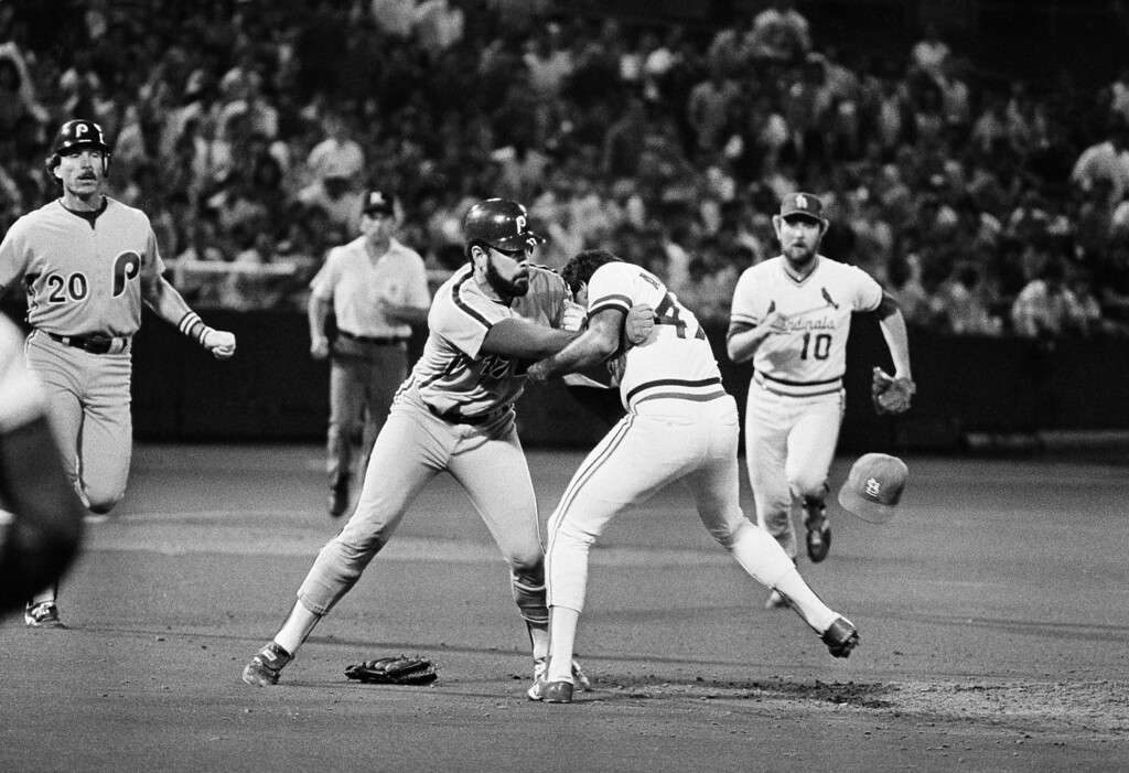 . St. Louis Cardinals\' pitcher Joaquin Andujar, right, and the Philadelphia Phillies\' Ozzie Virgil stand toe-to-toe in a struggle during the sixth inning of the St. Louis Cardinals-Phillies baseball game in St. Louis, June 5, 1984. Virgil charged the mound after almost being hit by Andujar, both teams benches rushed onto the field. Virgil was kicked out of the game. Rushing up to break up the struggle are Ken Oberkfell, #10 and 3rd base umpire Edward Montague. (AP Photo)