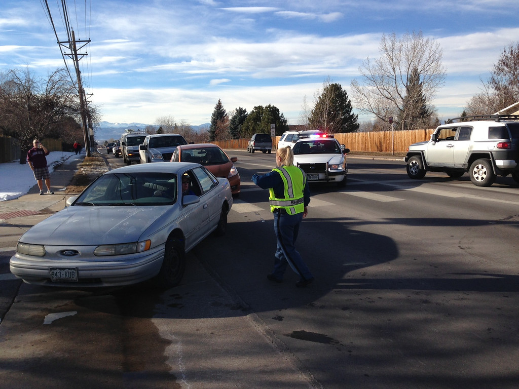 . Emergency responders direct traffic outside Arapahoe High School in Centennial, Colo. after reports of shots fired inside the school on Friday afternoon, Dec. 13, 2013. (Photo by Craig F. Walker/The Denver Post)