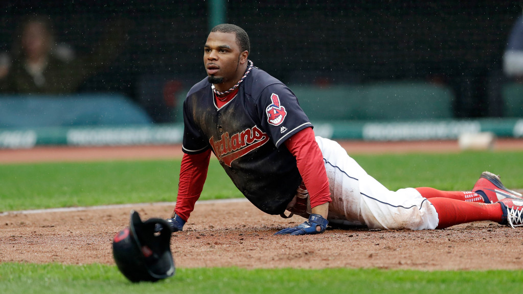 . Cleveland Indians\' Rajai Davis looks up after getting tagged out by Chicago Cubs catcher Willson Contreras at home plate in the third inning of a baseball game, Tuesday, April 24, 2018, in Cleveland. (AP Photo/Tony Dejak)