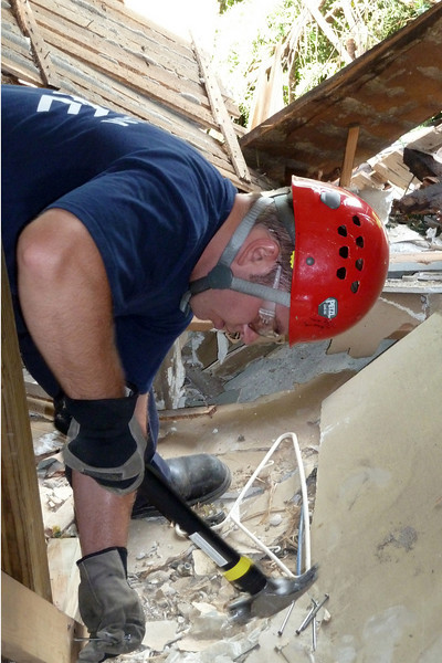Kozak Pounding nails.jpg