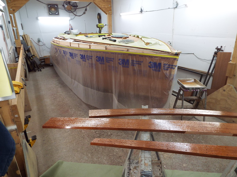 Starboard side cover boards with epoxy applied ready to install.