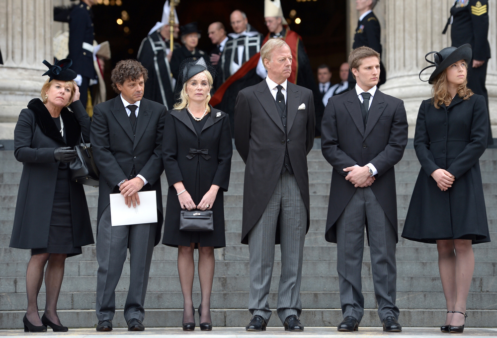 . Carol Thatcher, Marco Grass, Sarah Thatcher, Mark Thatcher, Michael Thatcher and Amanda Thatcher look on from the steps of St Paul\'s Cathedral as the coffin is placed in the hearse after the Ceremonial funeral of former British Prime Minister Baroness Thatcher at St Paul\'s Cathedral on April 17, 2013 in London, England. Dignitaries from around the world today join Queen Elizabeth II and Prince Philip, Duke of Edinburgh as the United Kingdom pays tribute to former Prime Minister Baroness Thatcher during a Ceremonial funeral with military honours at St Paul\'s Cathedral. Lady Thatcher, who died last week, was the first British female Prime Minister and served from 1979 to 1990.  (Photo by Jeff J Mitchell/Getty Images)