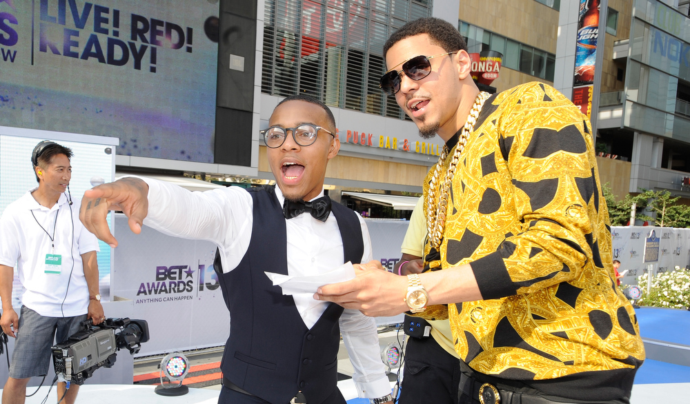 Description of . Rappers Bow Wow (L) and J. Cole attend the106 & Park Stage Pre-Show during the BET Awards at Nokia Theatre L.A. Live on June 30, 2013 in Los Angeles, California.  (Photo by John Ricard/Getty Images for BET)