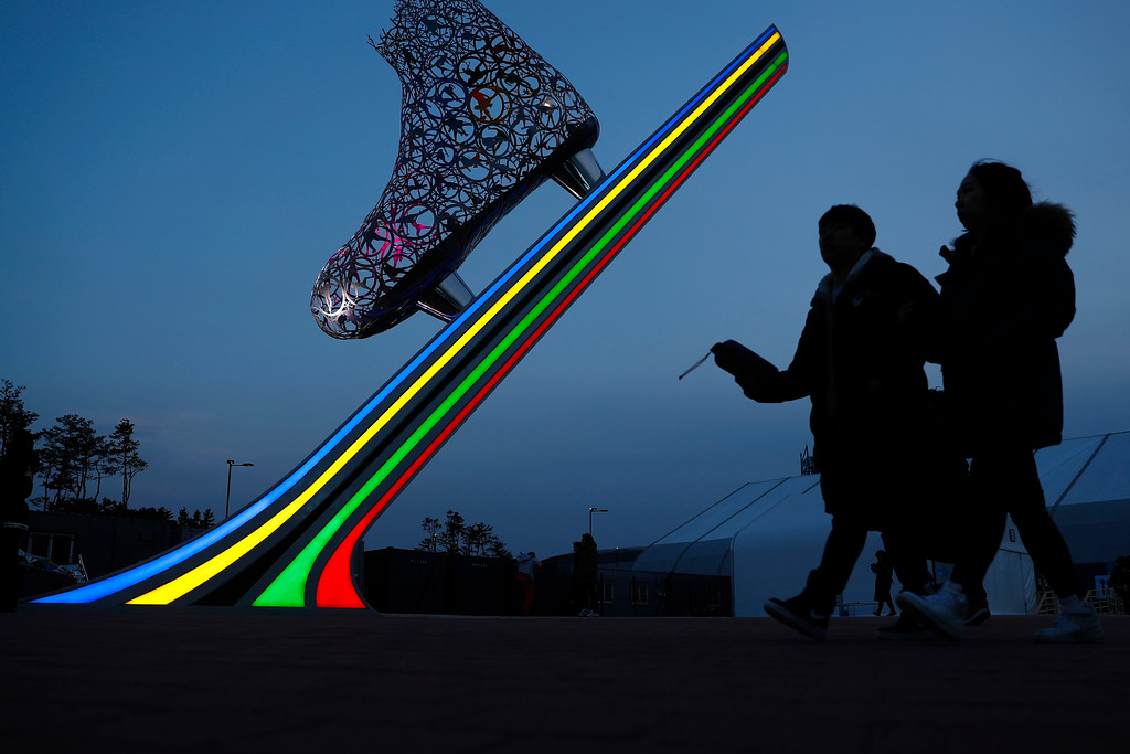 . Spectators arrive for the women\'s 1,000 meters speedskating race at the Gangneung Oval at the 2018 Winter Olympics in Gangneung, South Korea, Wednesday, Feb. 14, 2018. (AP Photo/John Locher)