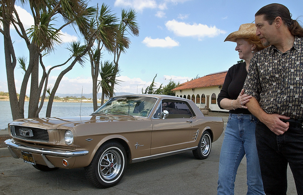 . Dean and Beverly Avery gaze at their 1966 Ford Mustang coupe Monday, Sept. 20, 2004, in San Leandro, Calif.  Baby boomers longing to buy the autos they coveted but couldn\'t afford in their youth are driving a surge in the classic car market. (AP Photo/Ben Margot)