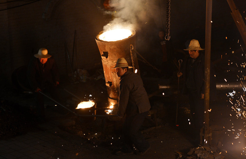 . Chinese blacksmiths man a furnace as they prepare to throw the molten metal against a cold stone wall to create sparks, during the Lantern Festival which traditionally marks the end of the Lunar New Year celebrations, in Nuanquan, Hebei province on February 24, 2013.  For over 300 years, the village which is famous for its blacksmith skills, has maintained the tradition which they considered a cheaper alternative than buying fireworks during the Lantern Festival.       MARK RALSTON/AFP/Getty Images