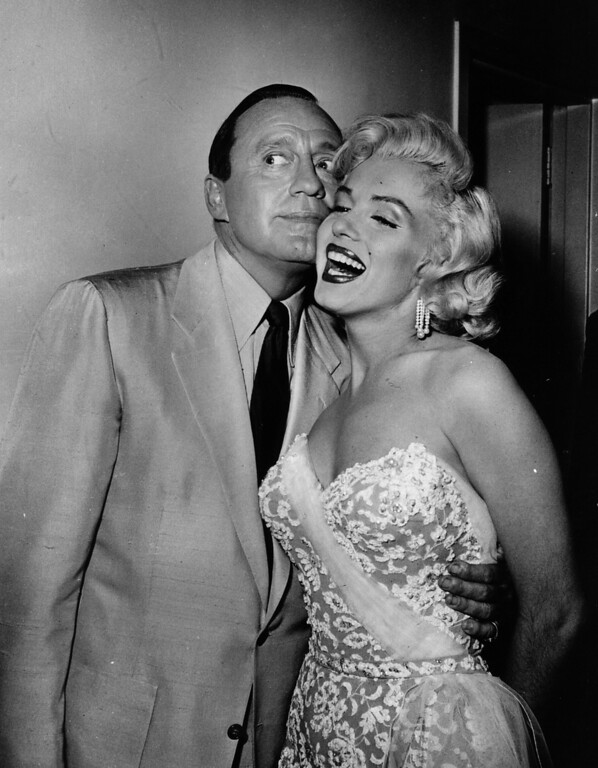 . American film star Marilyn Monroe (1926  - 1962) shares a joke with Jack Benny, comedian of radio, television and occasional films.   Original Publication: People Disc - HW0707   (Photo by Keystone/Getty Images)