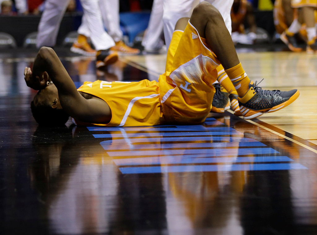 . Tennessee\'s Jordan McRae lays on the court after an NCAA Midwest Regional semifinal college basketball tournament game against the Michigan Friday, March 28, 2014, in Indianapolis. Michigan won 73-71.(AP Photo/David J. Phillip)