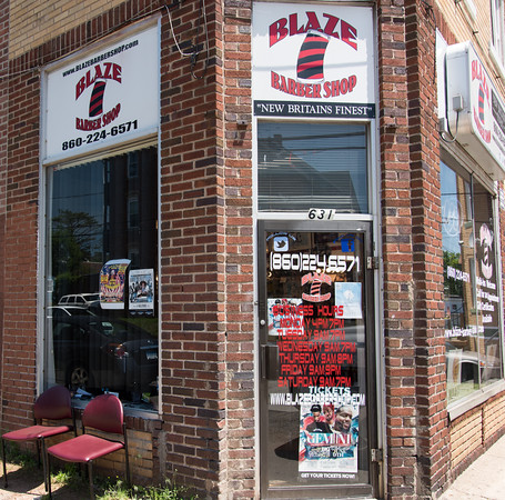 05/24/18 Wesley Bunnell | Staff Blaze Barber Shop on West Main St where discussions occur everyday including topics as the NFL's recent decision to require on field personnel to stand for the National Anthem.