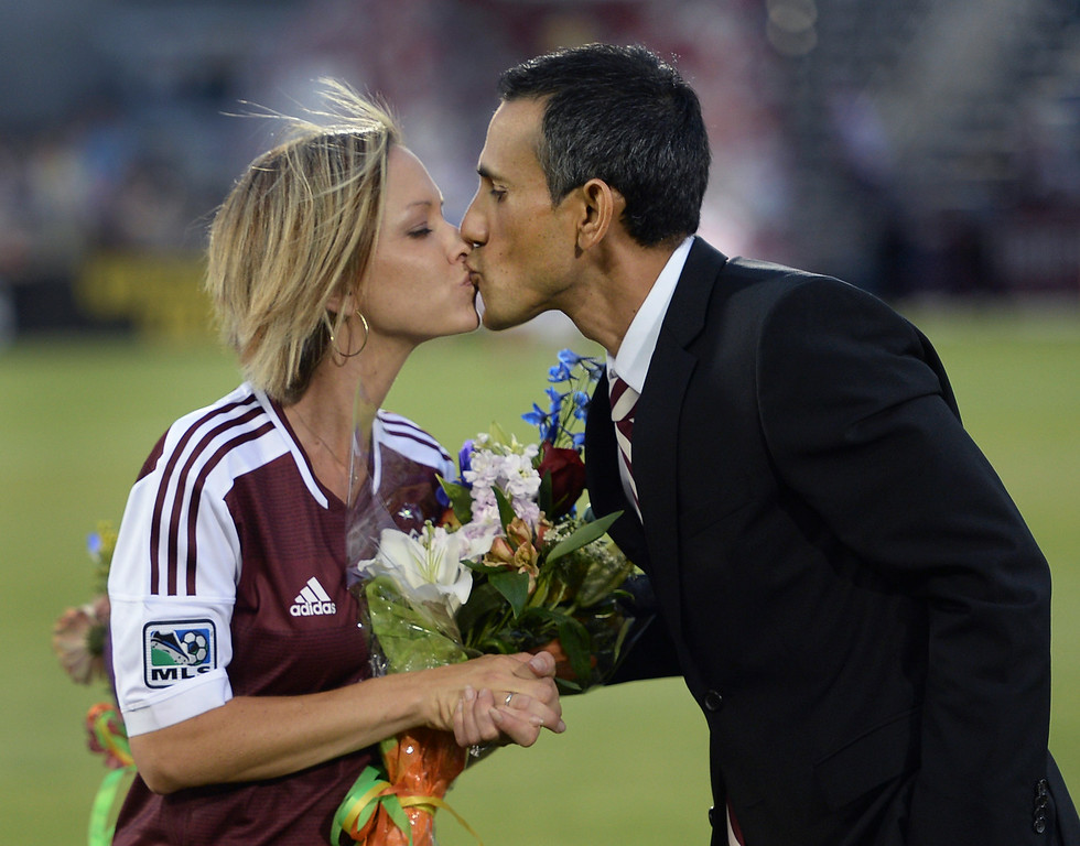 . Colorado coach Pablo Mastroeni shared a kiss with his wife as he was honored with a spot on the team\'s gallery of honor at the stadium Friday night. The Colorado Rapids hosted Chivas USA at Dick\'s Sporting Goods Park Friday night, July 25, 2014. Photo by Karl Gehring/The Denver Post