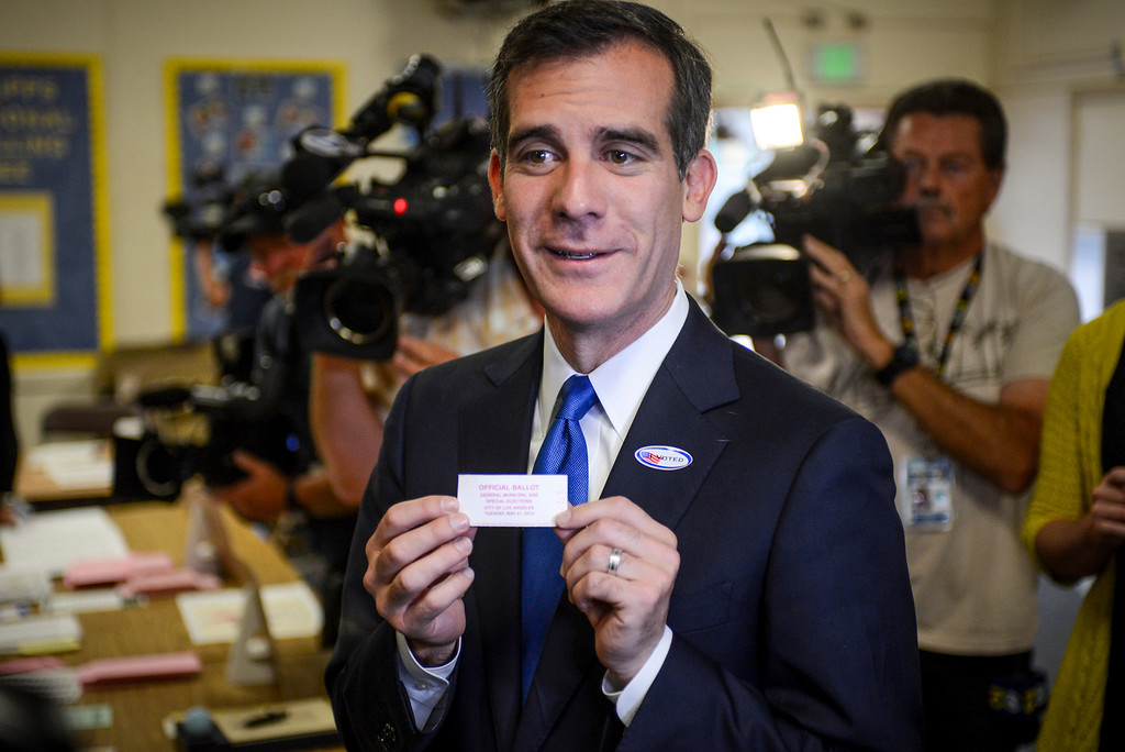 ". Mayoral candidate Eric Garcetti show off his ""I voted\"" sticker at Allesandro Elementary school in Los Angeles early Tuesday morning.  Los Angeles residents will vote for a new mayor, Garcetti or Wendy Gruel in the citywide election.  Photo by David Crane/Staff Photographer"