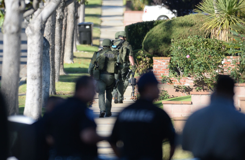 . A man allegedly shot an Inglewood police officer Wednesday, November 27, 2013, in Inglewood, CA, and the took hostages as he barricaded inside a house on S. 5th Avenue.  SWAT officers take positions one block west of the house. Photo by Steve McCrank/DailyBreeze