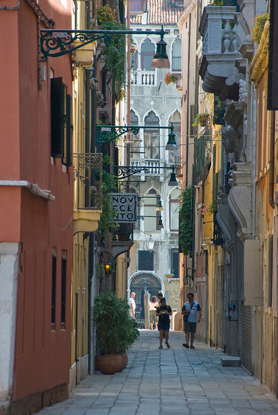 Tourists walking on an alley in Venice, Italy
