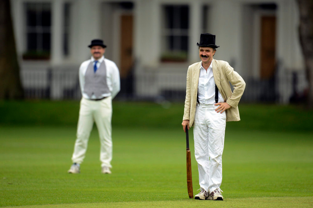 . Author William Fiennes (R) takes part in a Victorian Cricket match to commemorate the 150th anniversary of Wisden Cricketers\' Almanack  at Vincent Square in London May 29, 2013. REUTERS/Philip Brown