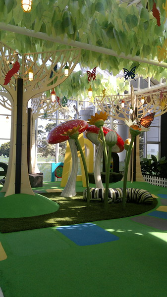 grub mushroom plant and tree sculptures on artificial turf and hanging leaves