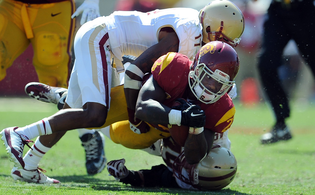 . Southern California running back Tre Madden (23) dives for the first down against Boston College during the second half of an NCAA college football game in the Los Angeles Memorial Coliseum in Los Angeles, on Saturday, Sept. 14, 2013. Southern California won 35-7. 