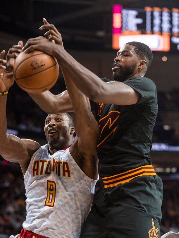 . Atlanta Hawks\' Dwight Howard (8) and Cleveland Cavaliers\' Tristan Thompson vie for a rebound during the first half of an NBA basketball game in Cleveland, Tuesday, Nov. 8, 2016. (AP Photo/Phil Long)