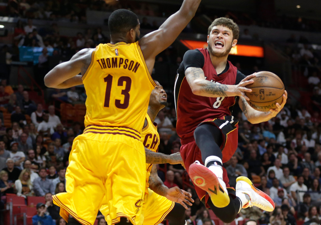 . Miami Heat\'s Tyler Johnson (8) drives to the basket as Cleveland Cavaliers\' Tristan Thompson (13) defends during the second half of an NBA basketball game, Saturday, March 4, 2017, in Miami. The Heat defeated the Cavaliers 120-92. (AP Photo/Lynne Sladky)
