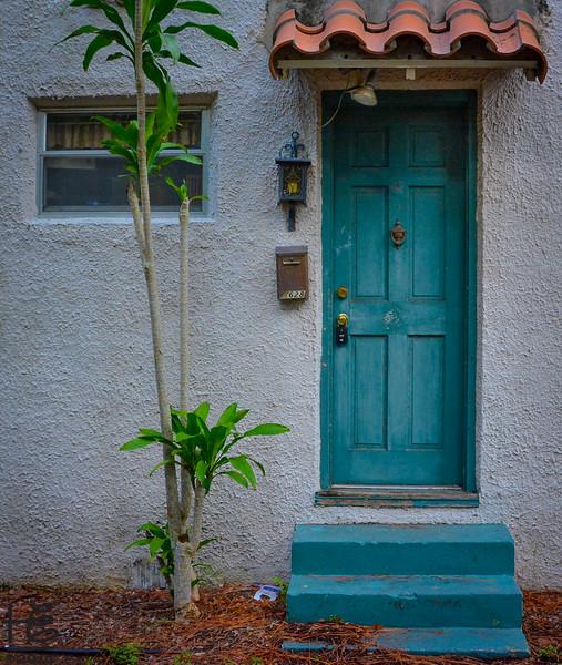 An older apt blue door