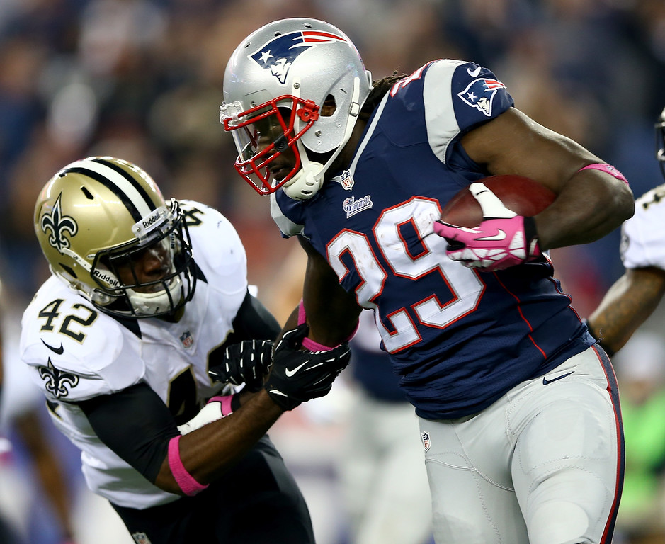 . LeGarrette Blount #29 of the New England Patriots carries the ball as  Isa Abdul-Quddus #42 of the New Orleans Saints defends at Gillette Stadium on October 13, 2013 in Foxboro, Massachusetts.The New England Patriots defeated the New Orleans Saints 30-27.  (Photo by Elsa/Getty Images)
