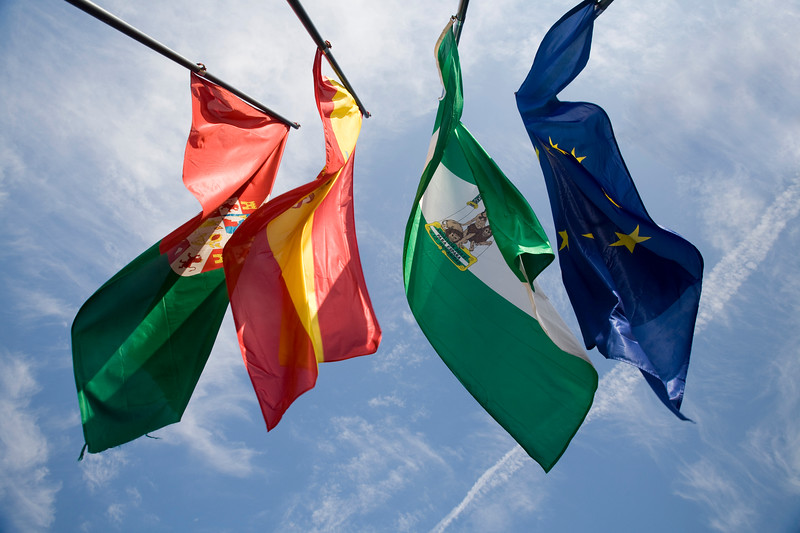 The flags of the European Union, Andalusia, Spain and Granada fluttering on the top of Torre de la Vela, Alhambra, Granada, Spain