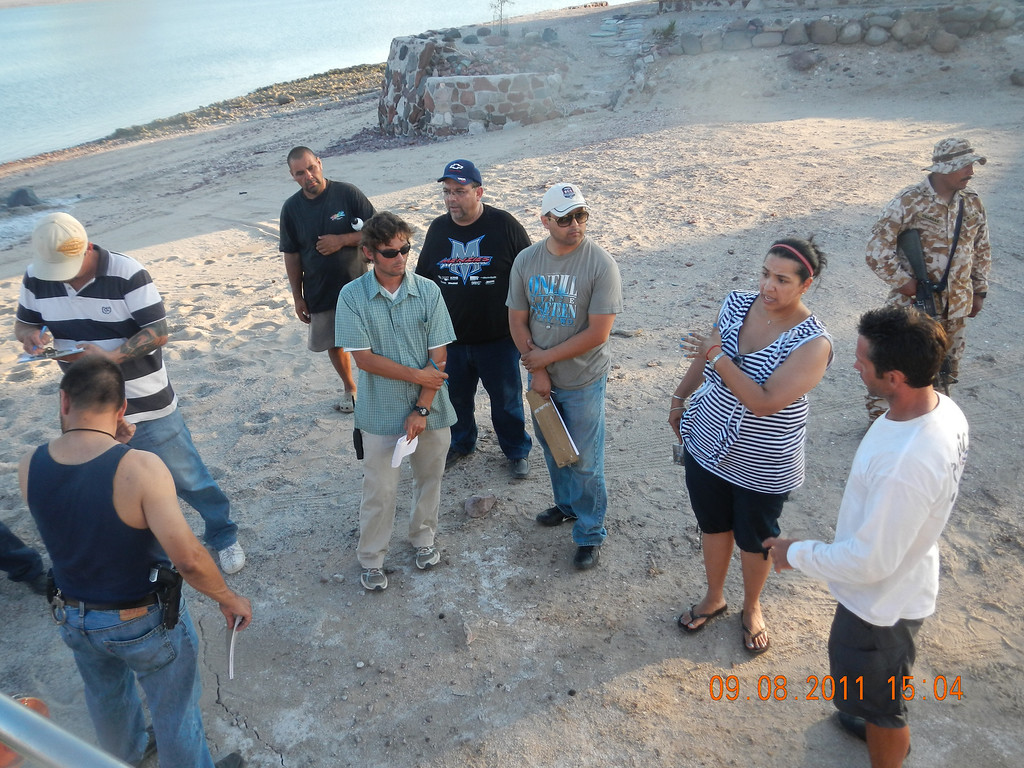 . Joe Jacinto, lower right, meets with U.S. Consulate, Mexican district attorney, State police and Marine officials, along with the land owner, after finding his stepfather\'s remains in September.  (Courtesy of Joe Jacinto)