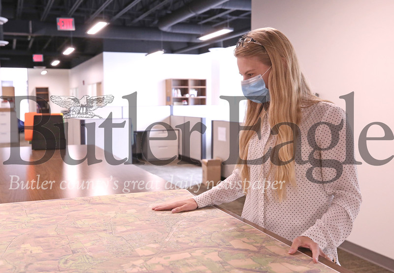 County mapper Ashley Gibson looks over an aerial map in the Government Center building's new second floor office space.  Seb Foltz/Butler Eagle