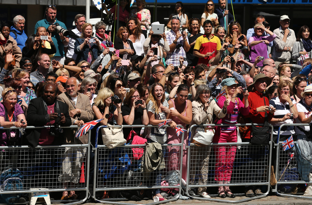 . Crowds stand outside a service of celebration to mark the 60th anniversary of the Coronation Queen Elizabeth II at Westminster Abbey on June 4, 2013 in London, England.  The Queen\'s Coronation took place on June 2, 1953 after a period of mourning for her father King George VI, following her ascension to the throne on February 6, 1952. The event 60 years ago was the first time a coronation was televised for the public.  (Photo by Dan Kitwood/Getty Images)