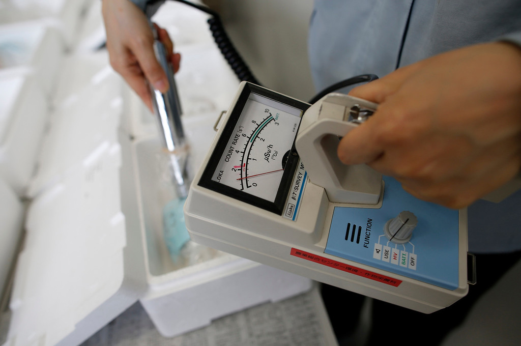 . A laboratory technician uses a Geiger counter to measure radiation levels in fish, which was caught close to the Fukushima Daiichi nuclear plant, at the Fukushima Agricultural Technology Centre in Koriyama, Fukushima prefecture May 28, 2013. Commercial fishing has been banned near the tsunami-crippled nuclear complex since the March 2011 tsunami and earthquake. The only fishing that still takes place is for contamination research, and is carried out by small-scale fishermen contracted by the government. Picture taken May 28, 2013. REUTERS/Issei Kato