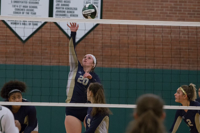Platt's Machaila Arjavich spikes for a kill Monday at Maloney High School in Meriden October 2, 2017 | Justin Weekes / For the Record-Journal