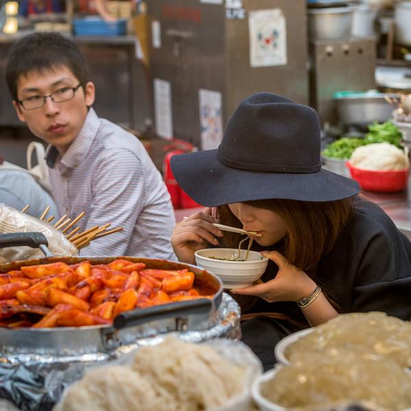 People eating at restaurant, Dongdaemun Market, Seoul, South Korea