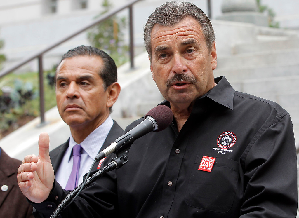. In this April 24, 2013 file photo, Los Angeles Police Chief Charlie Beck, right, speaks during a news conference in Los Angeles, as Los Angeles Mayor Antonio Villaraigosa stands next to him.  (AP Photo/Nick Ut, File)