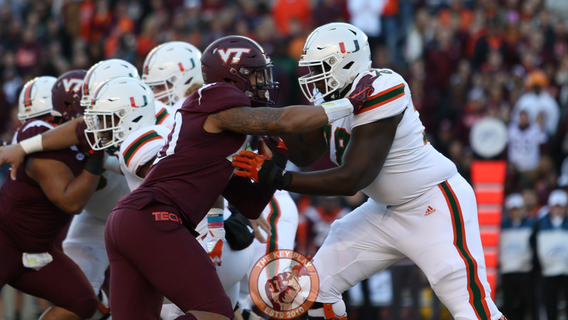 DL Emmanuel Belmar engages with Miami OL Tyree St. Louis. (Mark Umansky/TheKeyPlay.com)