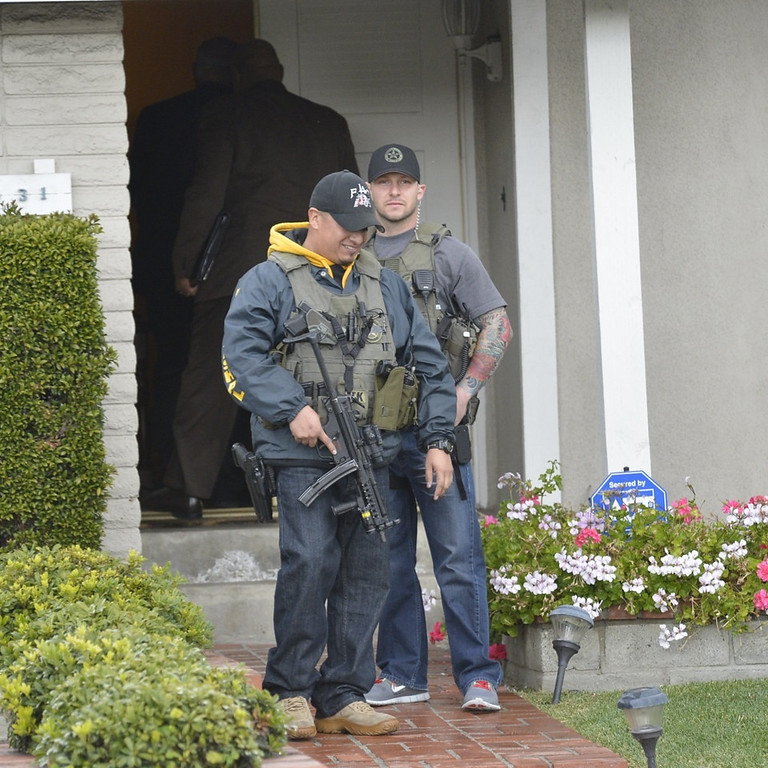 . Police investigate the home of the mother of the alleged triple-murder Christopher Dorner in La Palma, California on February 8, 2013. Photo by Jeff Gritchen / Los Angeles Newspaper Group