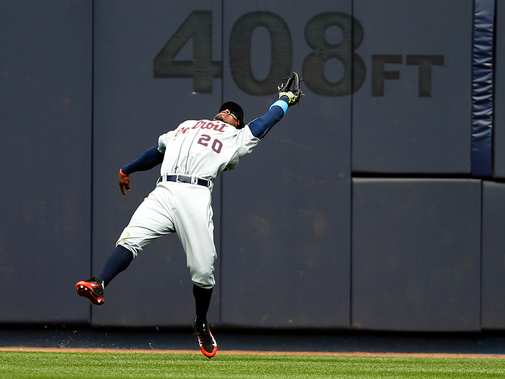 . Detroit Tigers center fielder Rajai Davis (20) fields Brian McCann\'s sixth-inning, flyout in a baseball game against the New York Yankees at Yankee Stadium in New York, Sunday, June 21, 2015.  (AP Photo/Kathy Willens)