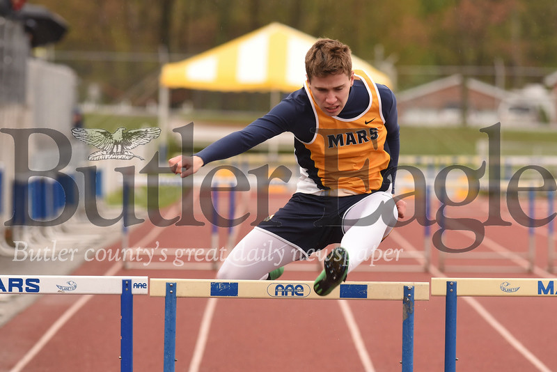Mars Blake Edwards clears one of the final hurdles on his way to 4th in the boys 300 hurdles Friday at the Mars Invitational.