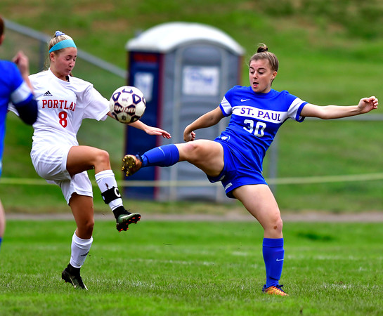 10/6/2018 Mike Orazzi | Staff Portland's Chrissy Picard (8) and St. Paul Girls Soccer's Emma Cretella (30) Saturday.